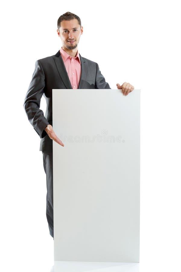 Uomo d'affari del legame del vestito che visualizza cartello immagine stock