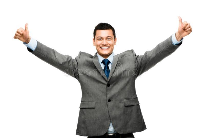 Uomo d'affari della corsa mista che celebra successo isolato sul BAC bianco fotografie stock libere da diritti