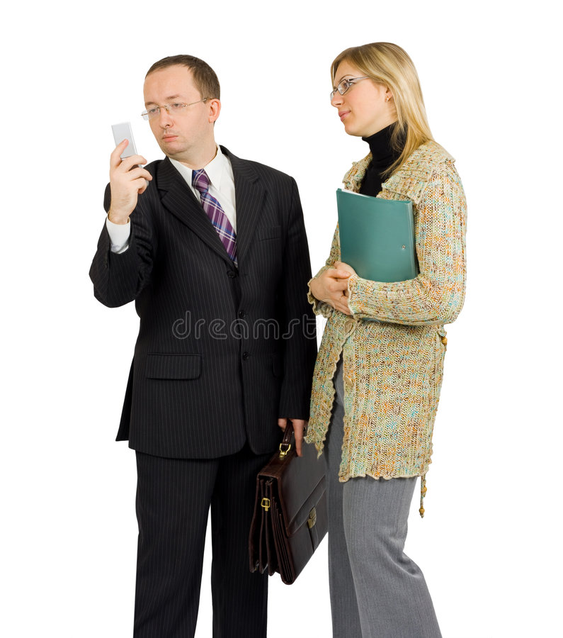 Uomo d'affari distratto da una chiamata di telefono fotografie stock libere da diritti