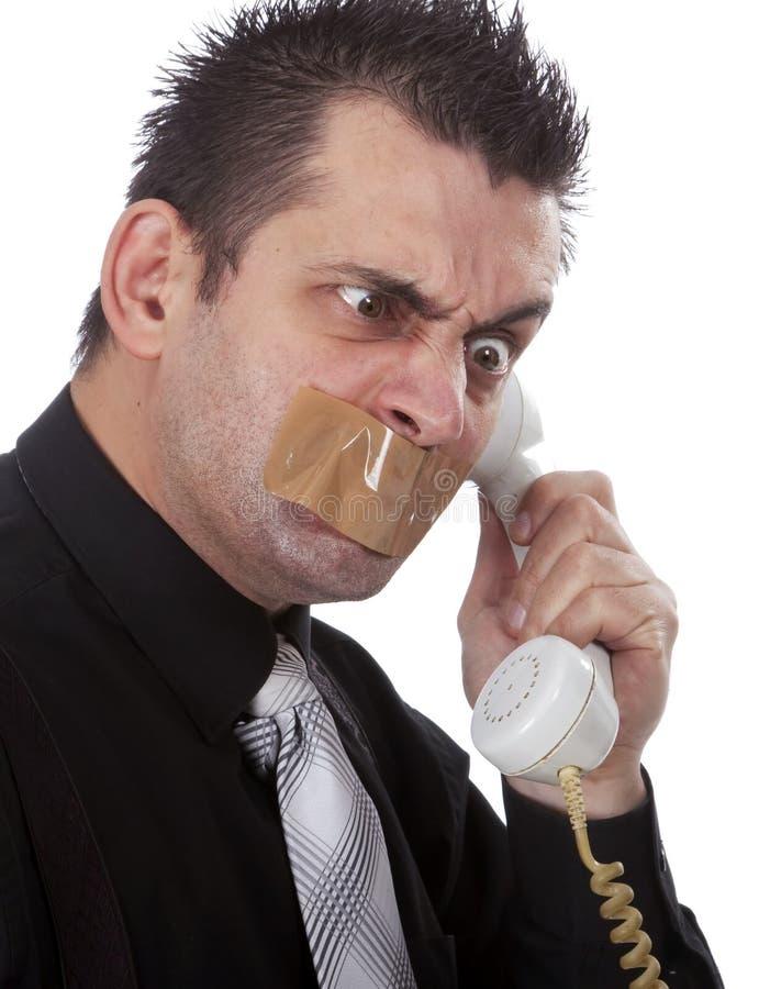 Uomo d'affari divertente con nastro adesivo sulla sua bocca immagine stock