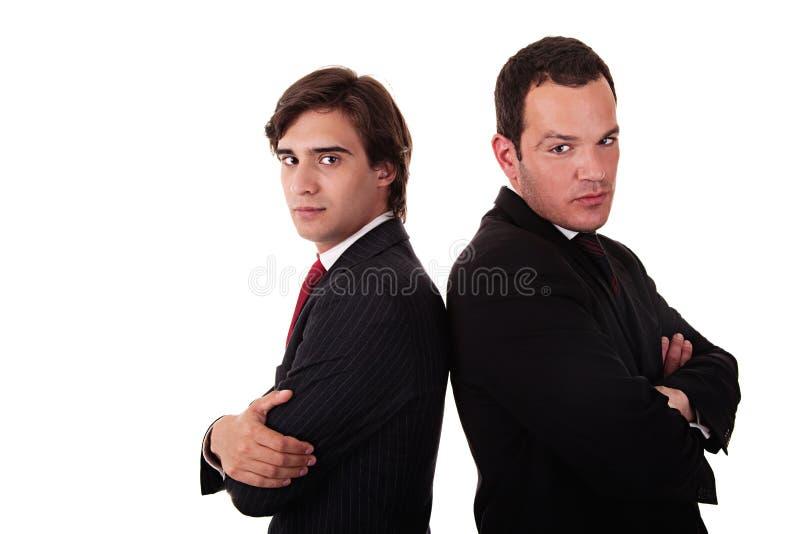Uomo d'affari due che si leva in piedi di nuovo alla parte posteriore fotografia stock