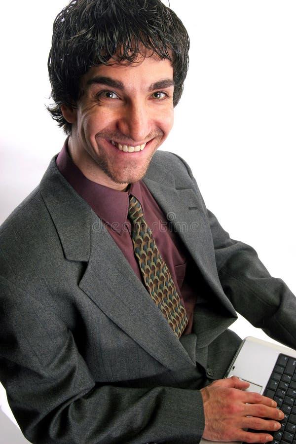 Uomo d'affari e computer portatile fotografia stock libera da diritti