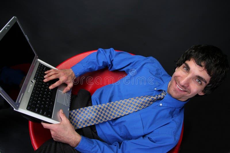 Uomo d'affari e computer portatile immagine stock libera da diritti