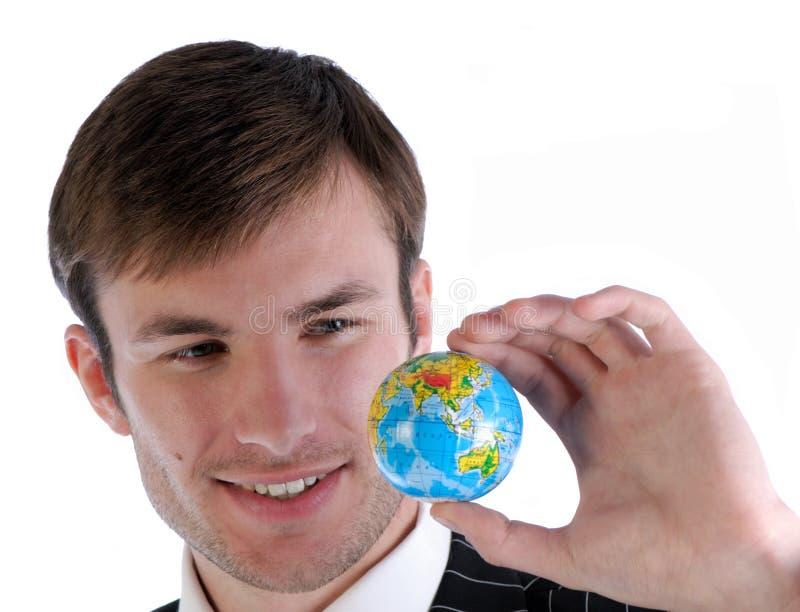 Uomo d'affari e globo fotografia stock