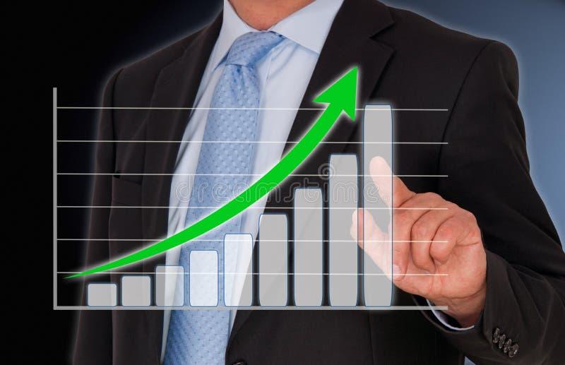 Uomo d'affari e grafico di crescita fotografie stock libere da diritti