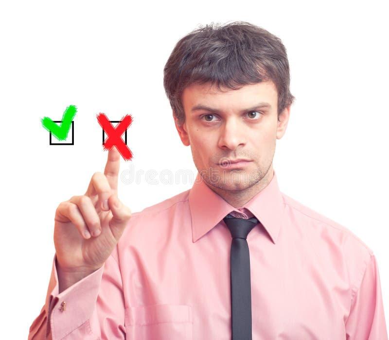 Uomo d'affari e tasti sì/no fotografia stock libera da diritti