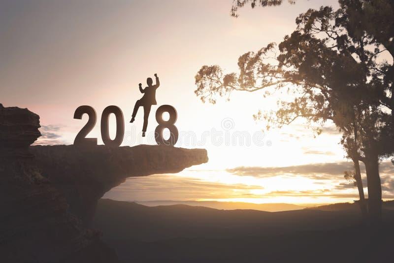Uomo d'affari emozionante della siluetta per il buon anno 2018 immagine stock libera da diritti