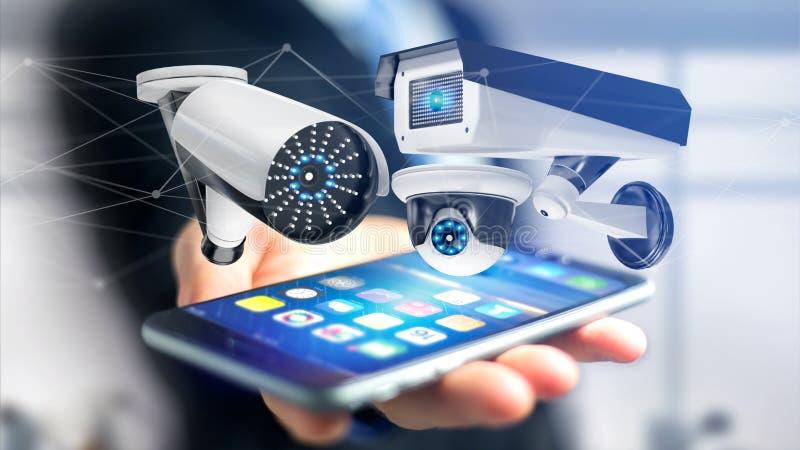 Uomo d'affari facendo uso di uno smartphone con un sistema della videocamera di sicurezza e immagini stock libere da diritti