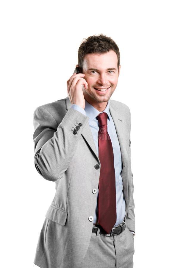 Uomo d'affari felice che comunica sul mobile immagine stock libera da diritti