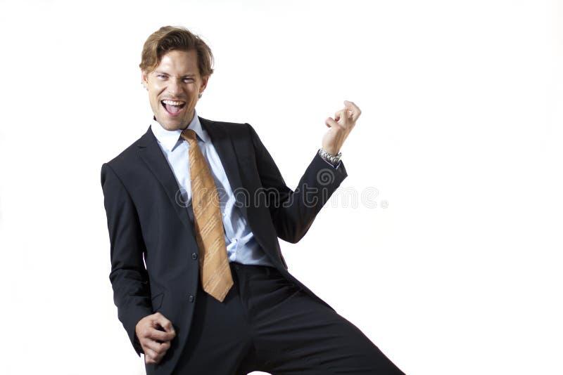 Uomo d'affari felice che lo oscilla fotografia stock