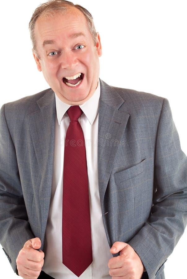 Uomo d'affari felice circa qualcosa fotografia stock