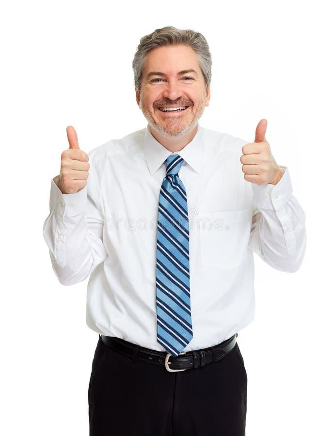 Uomo d'affari felice con i pollici immagine stock