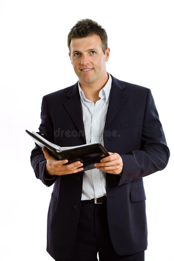 Uomo d'affari felice con il computer portatile isolato fotografia stock