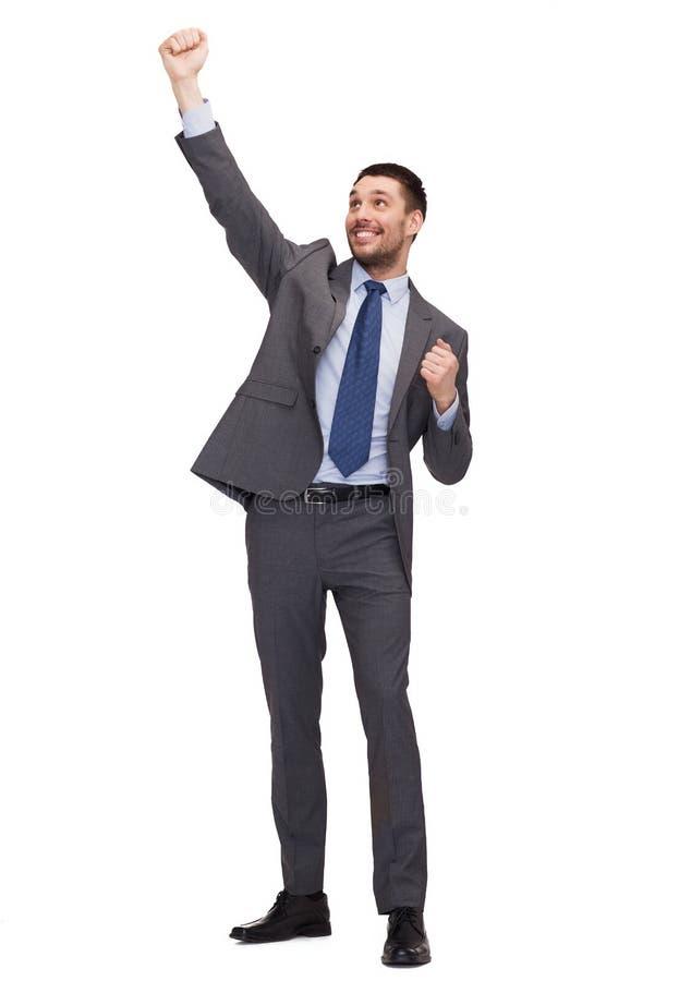 Uomo d'affari felice con le mani su fotografie stock libere da diritti