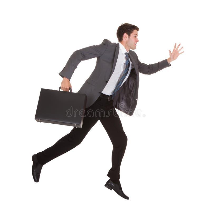 Uomo d'affari in fretta fotografie stock libere da diritti