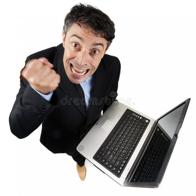 Uomo d'affari furioso che scuote il suo immagini stock