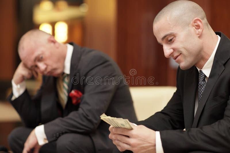 Uomo d'affari geloso fotografie stock libere da diritti