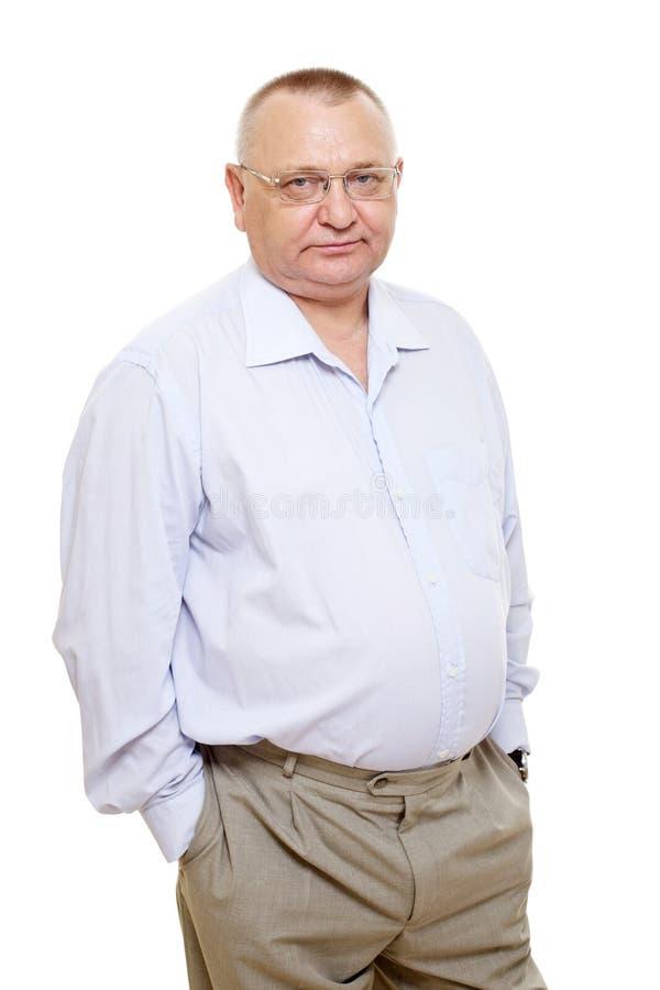 Uomo d'affari invecchiato centrale serio in vetri fotografia stock libera da diritti