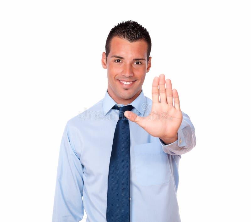 Uomo d'affari ispanico bello con l'alto gesto immagine stock