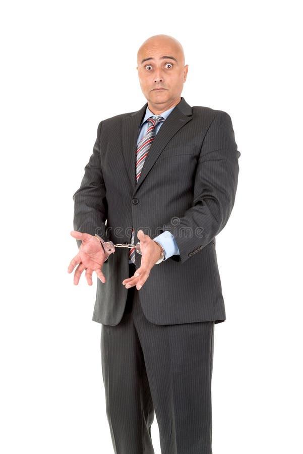 Uomo d'affari in manette fotografie stock