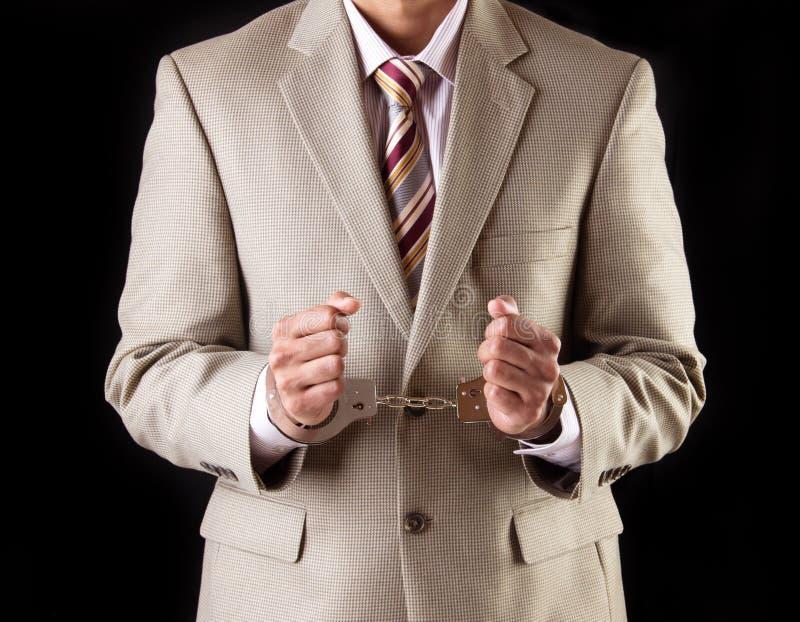 Uomo d'affari in manette - frode corporativa immagini stock
