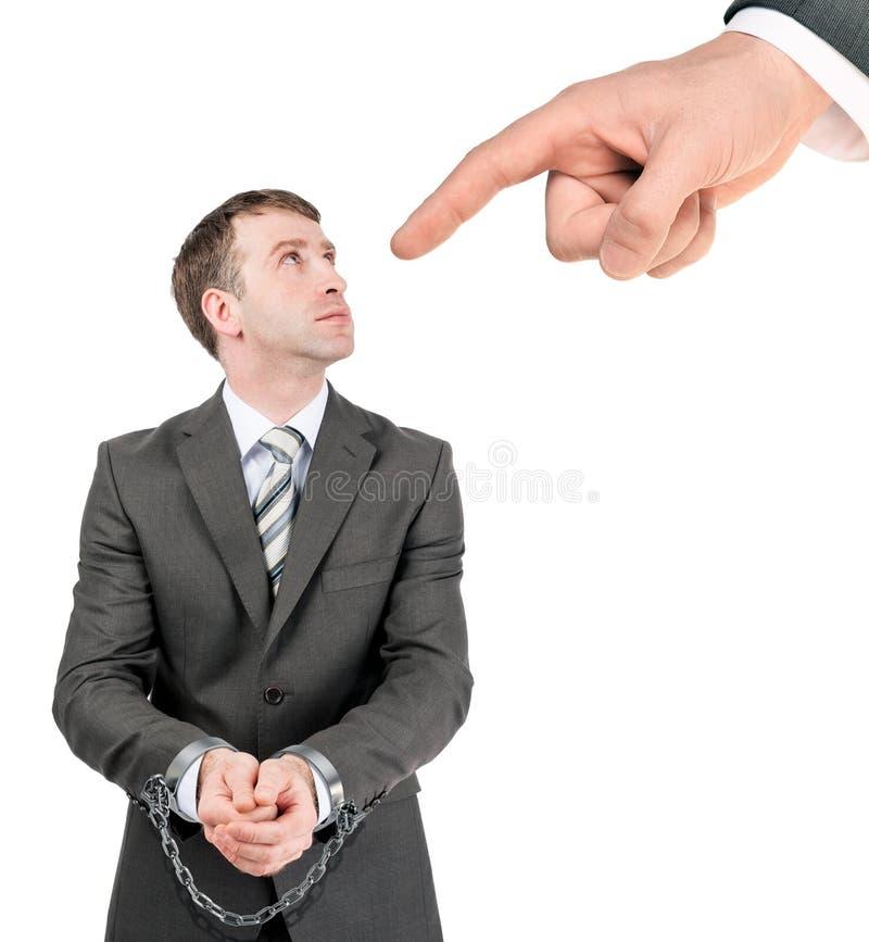 Uomo d'affari in manette punite fotografie stock