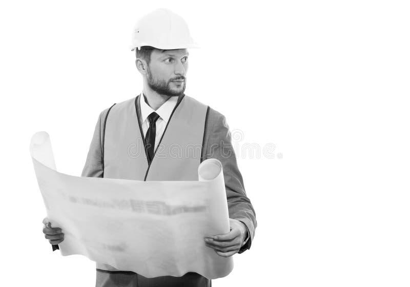 Uomo d'affari maschio professionale della costruzione con i suoi modelli fotografia stock