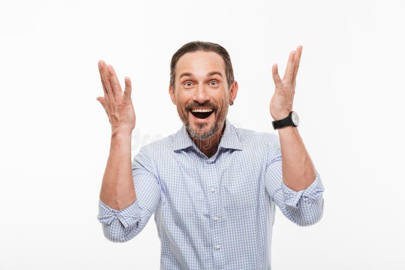 Uomo d'affari maturo bello emozionante allegro fotografia stock