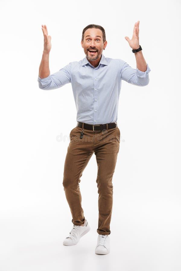 Uomo d'affari maturo bello emozionante allegro fotografia stock libera da diritti