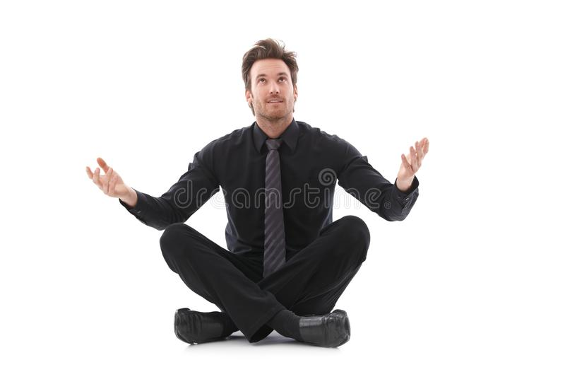 Uomo d'affari nella buona fortuna aspettante del sedile del sarto fotografia stock