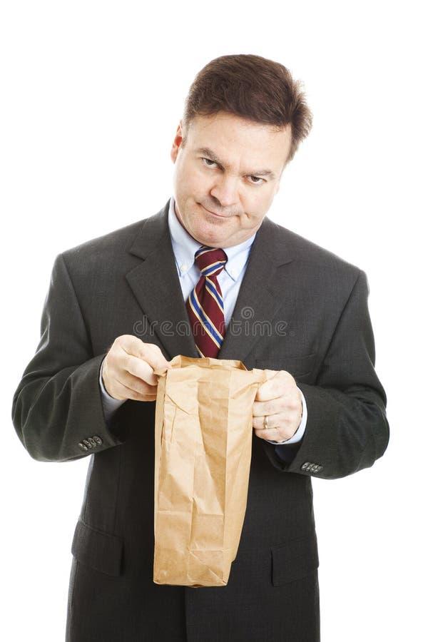 Uomo d'affari - pranzo d'alesaggio fotografia stock libera da diritti