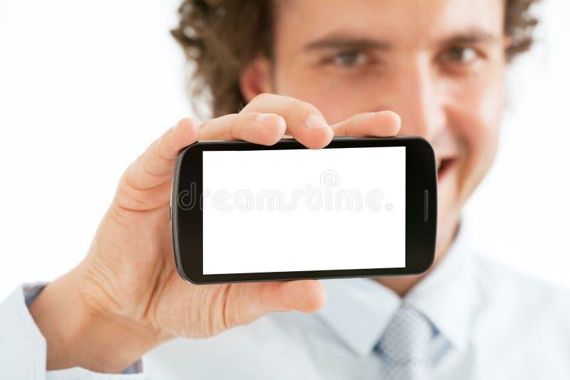 Uomo d'affari Presenting Smart Phone fotografie stock libere da diritti