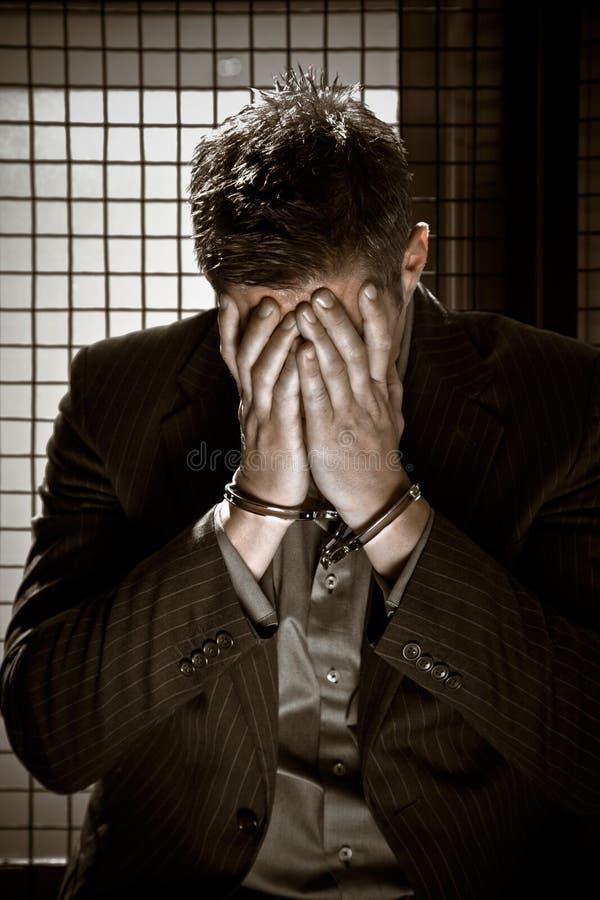 Uomo d'affari in prigione fotografie stock