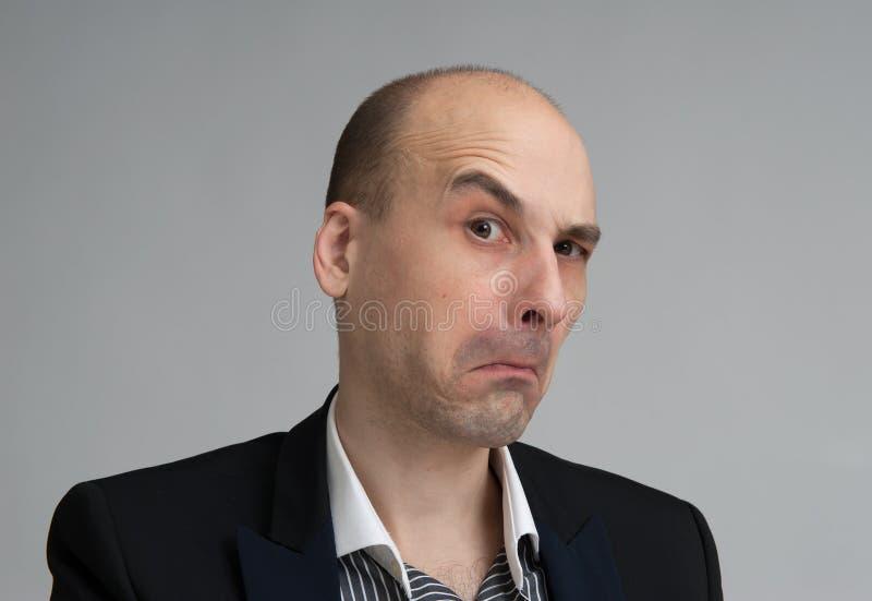 Uomo d'affari scettico immagini stock