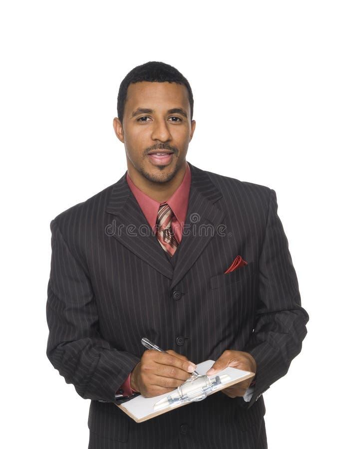 Uomo d'affari - scrittura sui appunti fotografia stock
