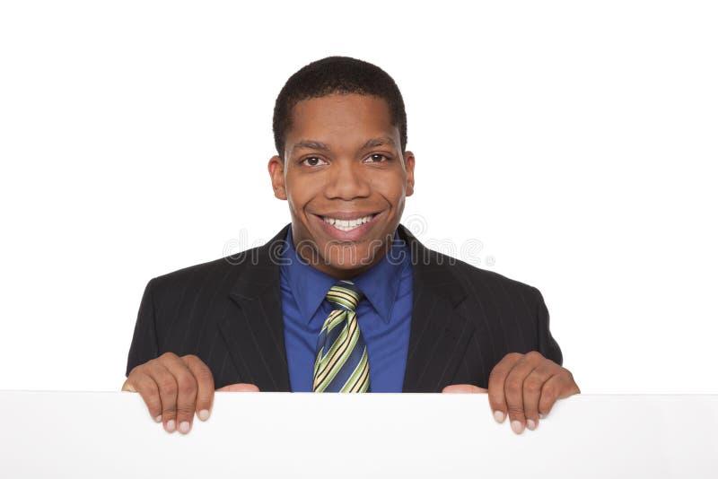 Uomo d'affari - segno in bianco fotografia stock