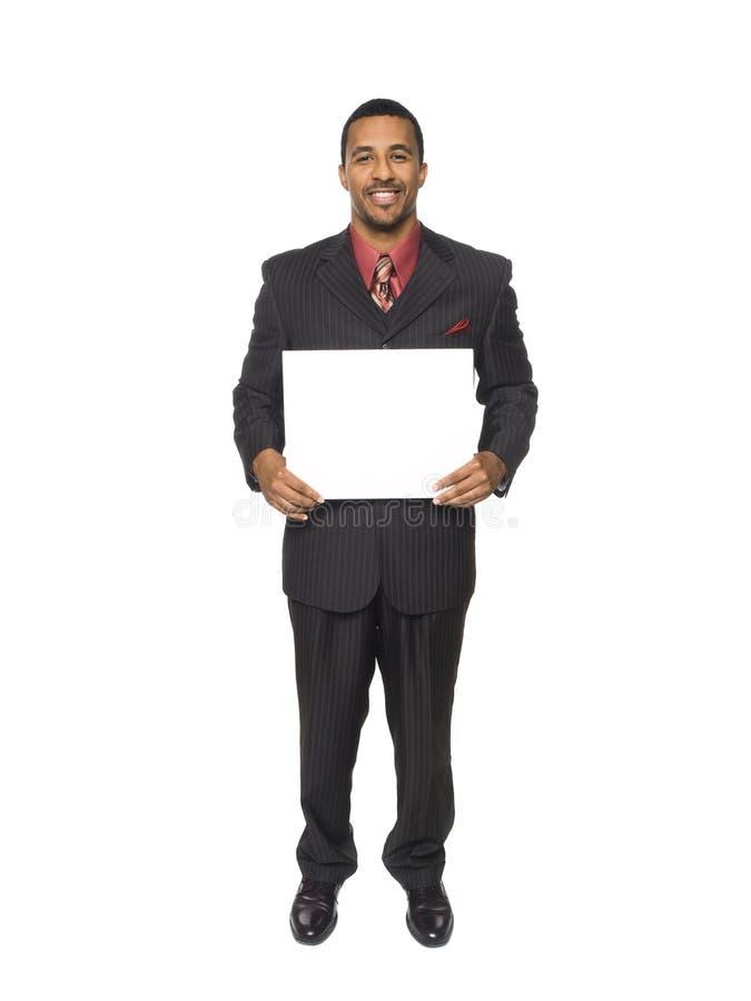 Uomo d'affari - segno in bianco felice immagine stock