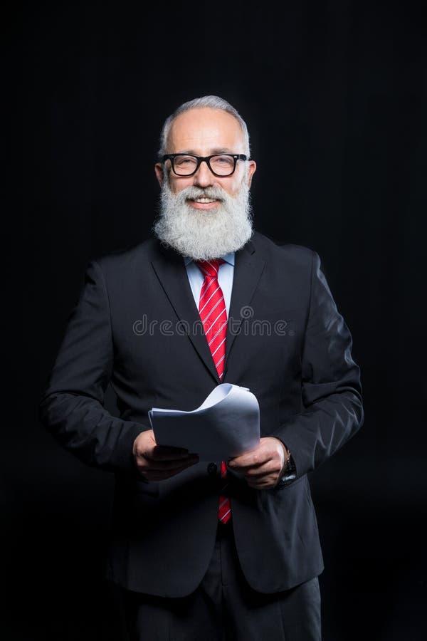 Uomo d'affari senior in occhiali fotografie stock libere da diritti