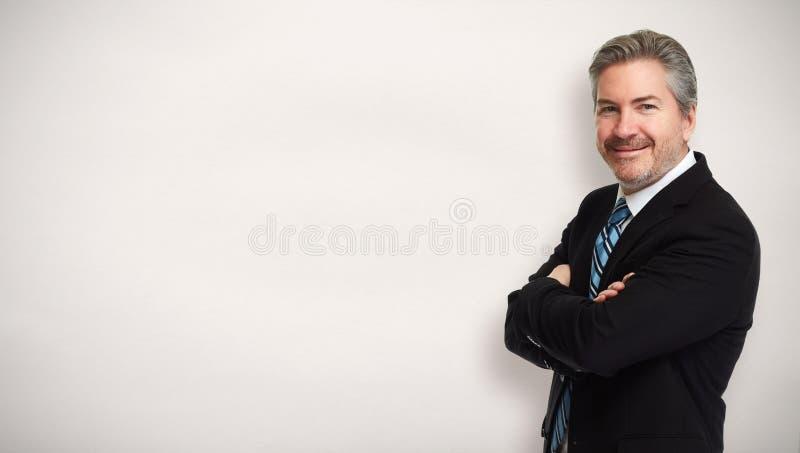 Uomo d'affari sorridente felice fotografia stock