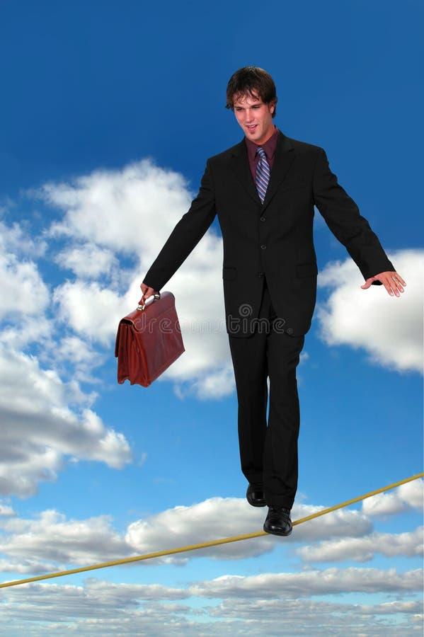 Uomo d'affari su Thightrope fotografie stock libere da diritti