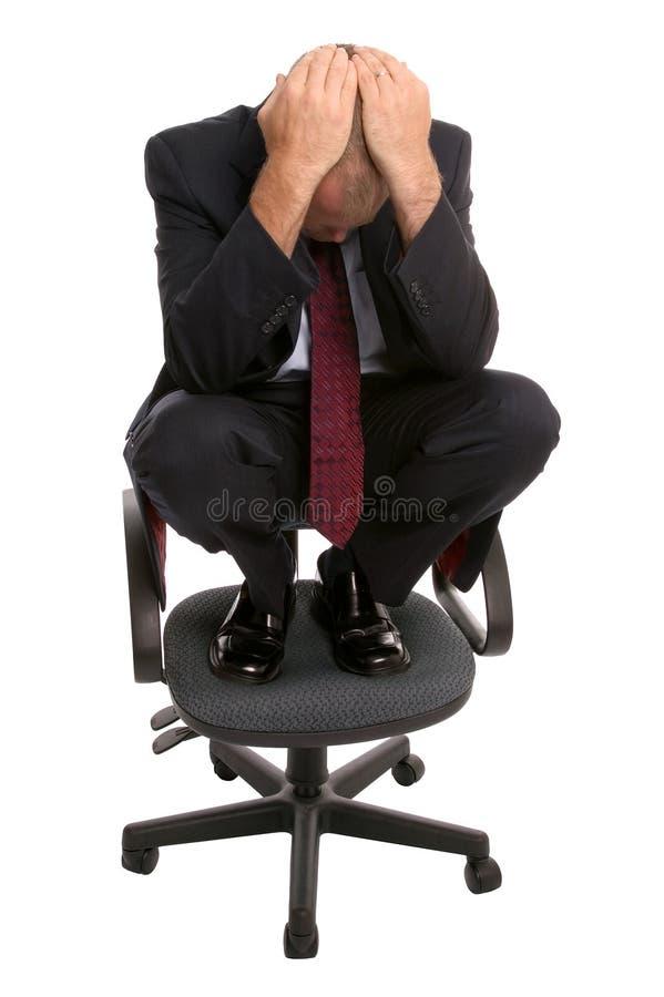 Uomo d'affari su una presidenza. fotografie stock libere da diritti