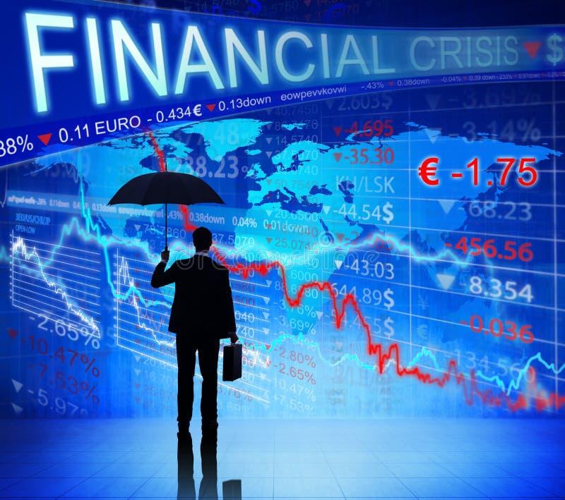 Uomo d'affari sul grafico blu di crisi finanziaria fotografia stock libera da diritti