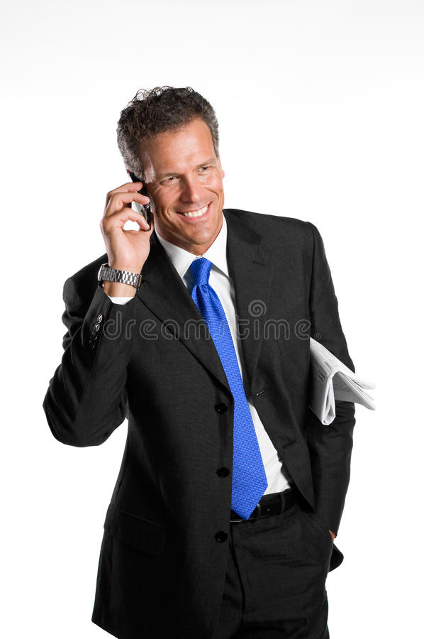 Uomo d'affari sul mobile fotografie stock