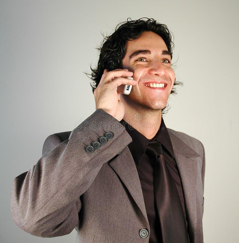 Uomo d'affari sul telefono immagine stock