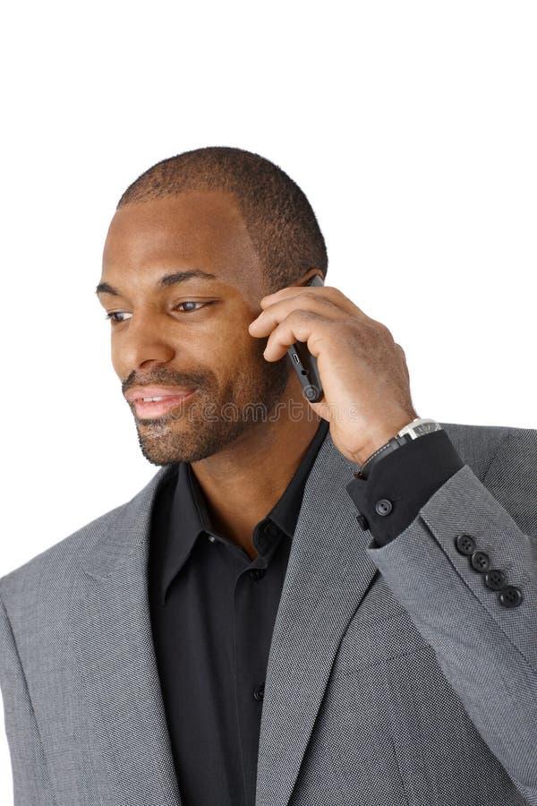 Uomo d'affari sulla chiamata di telefono cellulare immagine stock