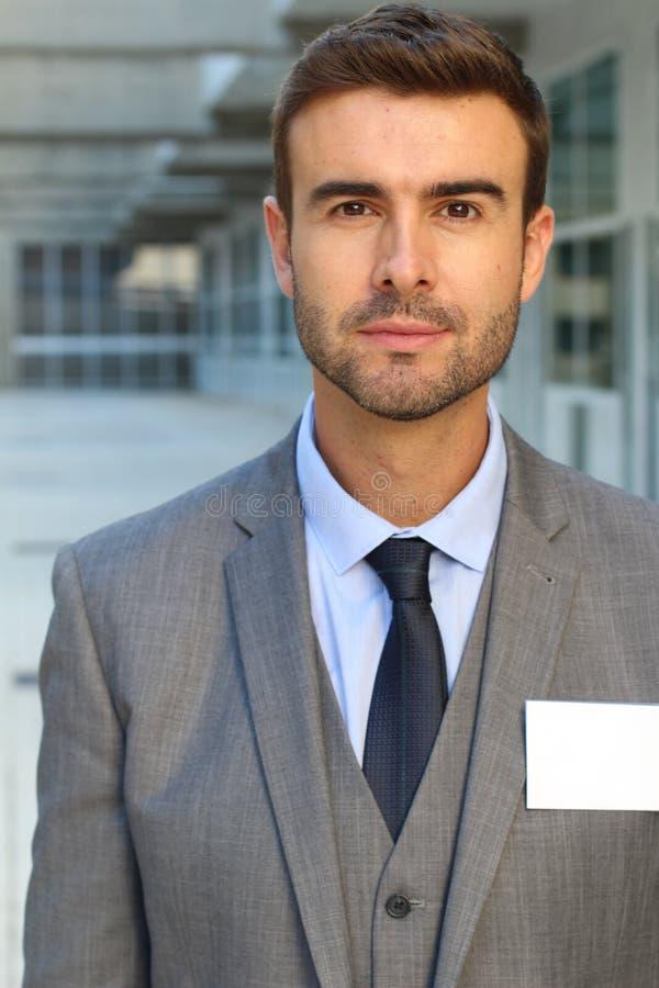 Uomo d'affari sveglio vestito per impressionare fotografia stock libera da diritti