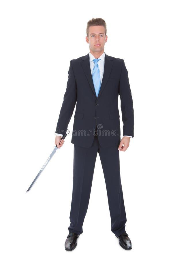 Uomo d'affari With Sword immagine stock libera da diritti