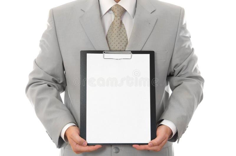 Uomo d'affari, tenente strato di carta con spazio vuoto fotografia stock libera da diritti