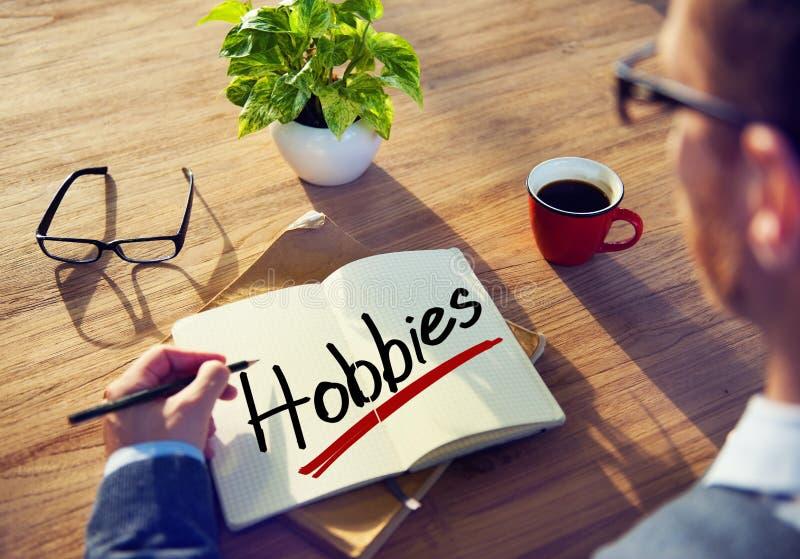 Uomo d'affari Thinking circa gli hobby di parola immagine stock