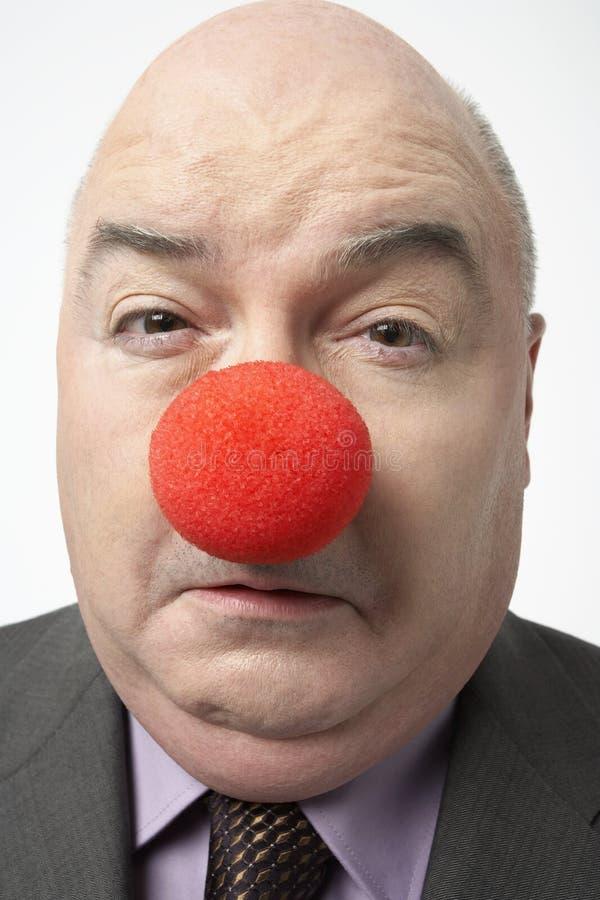 Uomo d'affari triste Wearing Clown Nose immagine stock libera da diritti